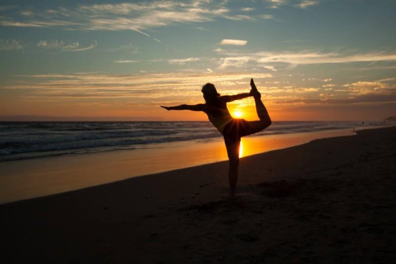 Doing yoga on the beach in California.