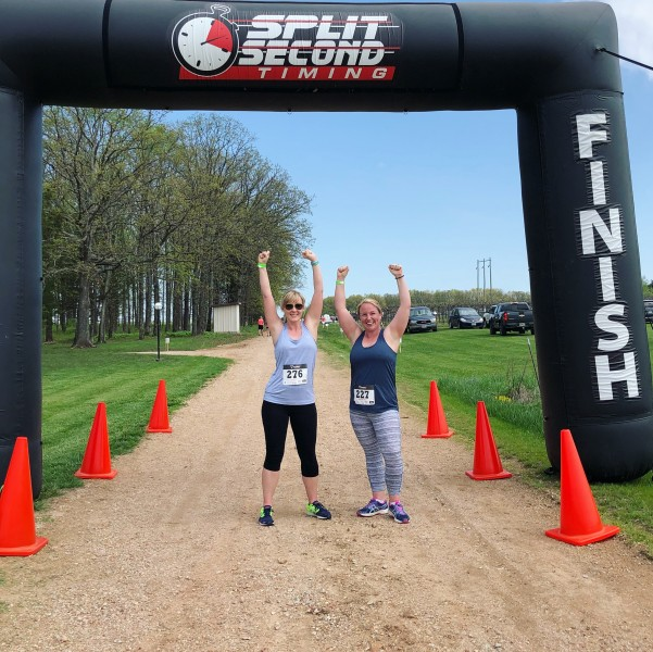 Tara and her best friend Lindsey after completing a 5K race.
