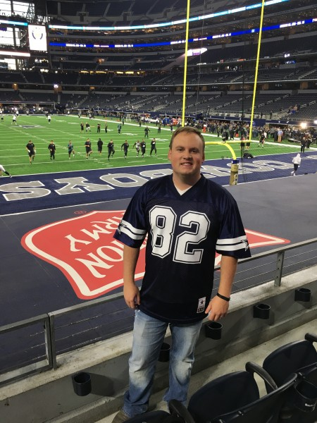 Supporting the Dallas Cowboys at a game in the AT&T Stadium.