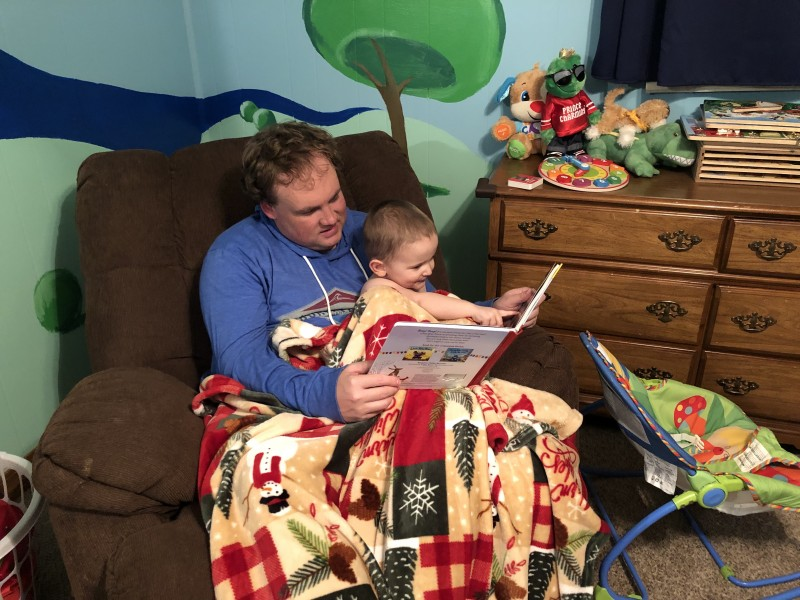 Reading a bedtime story to our friend's son, Surber.