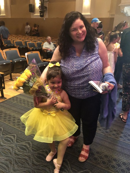 Luna's Tia Ann is very special to her and she brought Luna a bouquet of yellow roses to match her dress.