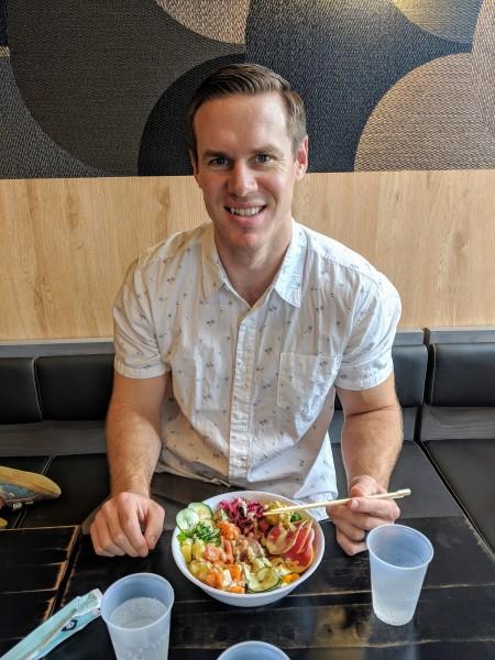 Adam eating poke bowl.