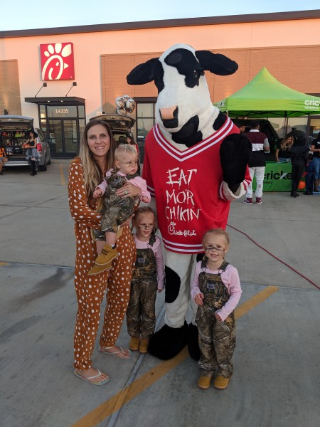 Sara posing with the girls and the Chic Fe Le cow during local Trunk or Treat event. Sara was an innocent deer and the girls were deer hunters.