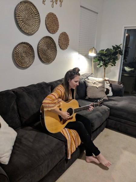 Sara playing her guitar.