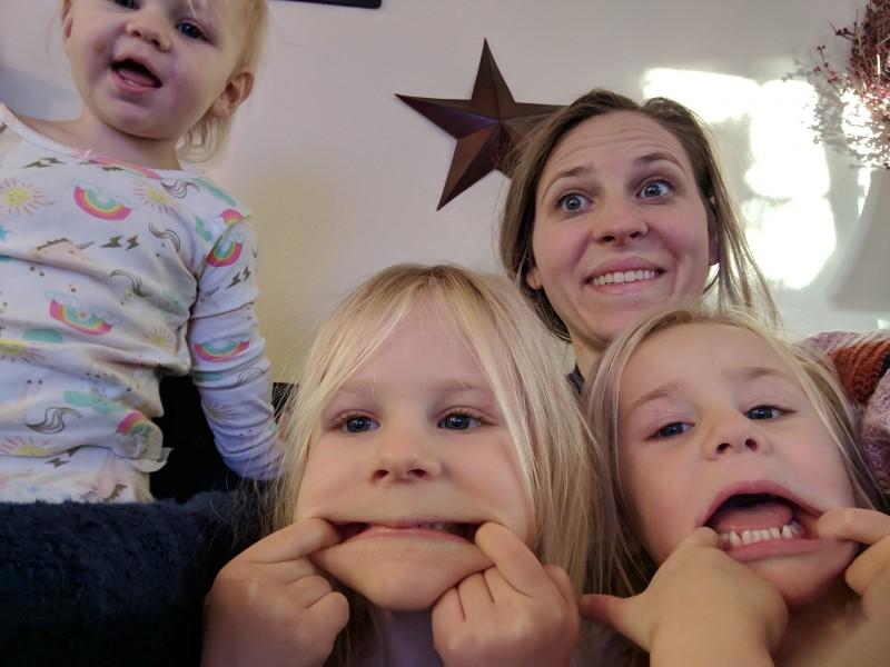 Sara and girls taking a morning selfie.