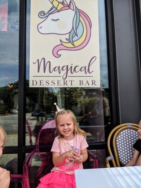 Everly posing for her 4th birthday at the Magical Dessert Bar.