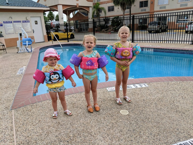 The girls having a day at the hotel pool during a Grandma Sharol visit.
