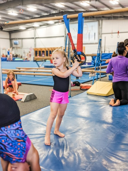 Everly strength training at gymnastics.