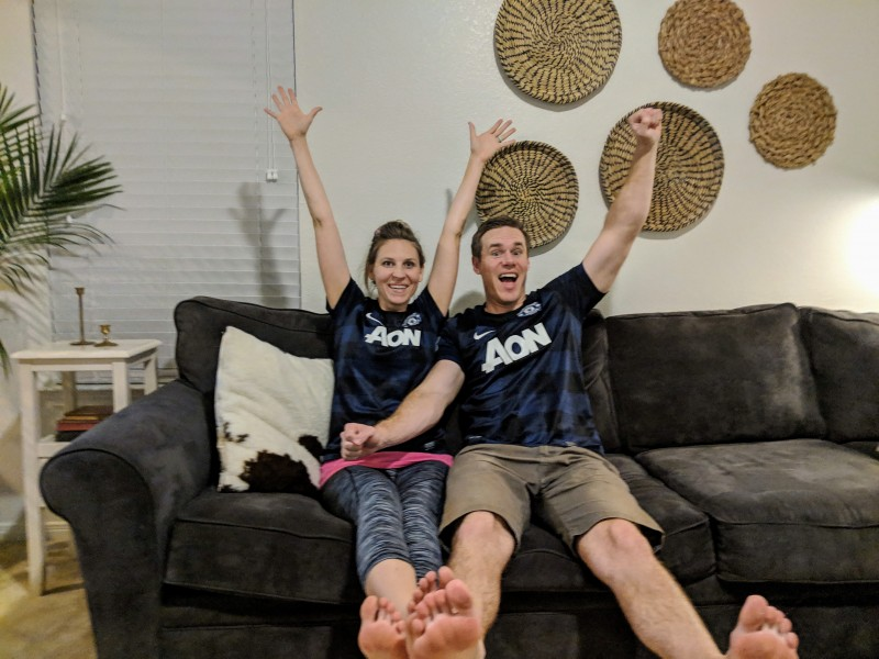 We love watching soccer together. GOAL!