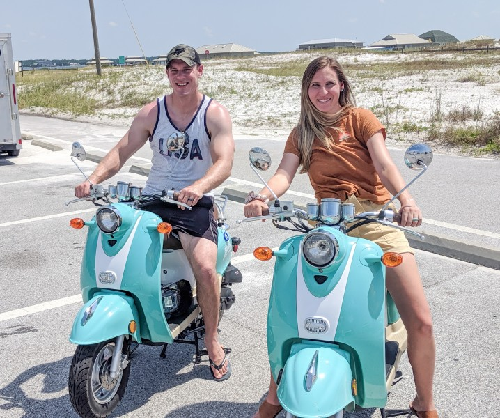 Riding scooters along the coast of Navarre Beach.