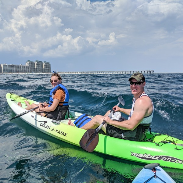 Enjoying a date day kayaking with friends on Navarre Beach vacation.