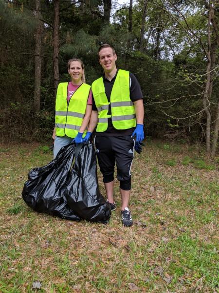 Adam and Sara picking up trash at church.
