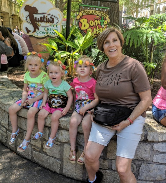 Grandma Sharol and the girls are posing together with their fanny packs. San Antonio Riverwalk.