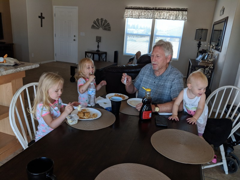 Papa George eating pancakes with the girls in Nevada.