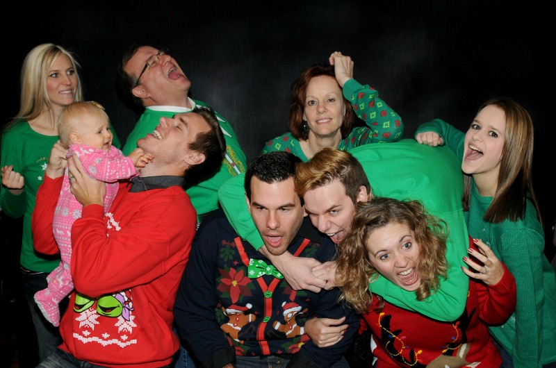 We took family pictures sporting ugly Christmas Sweaters. Emberlyn is just a baby in this picture. From top row left: Sara, Grandpa Bob, Grandma Laura, Uncle Nick (bending over), Aunt Jackie. Front row left: Baby Emberlyn, Adam, Uncle Zack Aunt Kayla