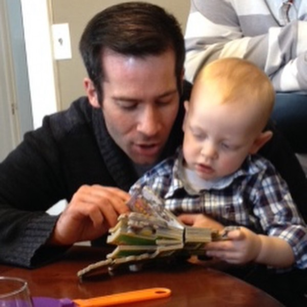 Paul reading to our godson, Miles (March 2016)