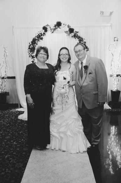 Here's Annie with her parents, Paula and Tom - not pictured is her younger sister Katie, who was in labor on the day of the wedding!