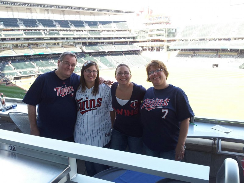 Here's Annie with her entire immediate family - her parents and her younger sister Katie - at a Minnesota Twins game in 2012