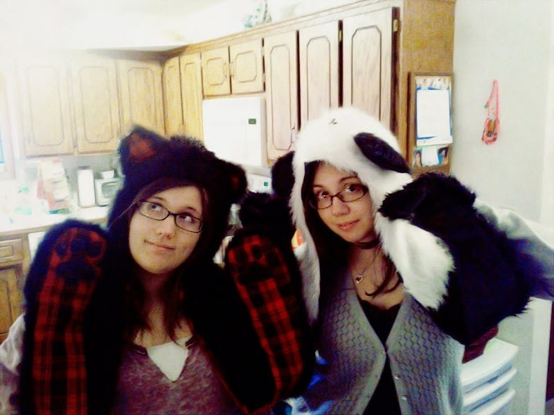 Annie and Katie being goons wearing bear hats and gloves