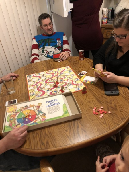 Playing board games with Annie's family on Christmas Eve