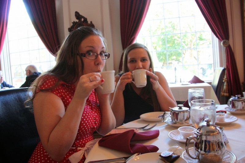 Annie and Emily sipping tea at Annie's bachelorette luncheon