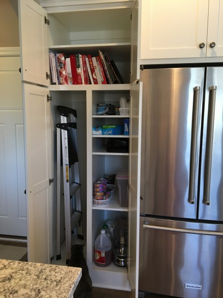 We're able to have a full pantry, plus room for utility items such as stepladders.