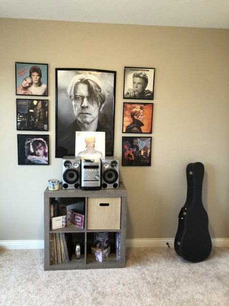 Annie's office features framed albums by her favorite musical artist, David Bowie.