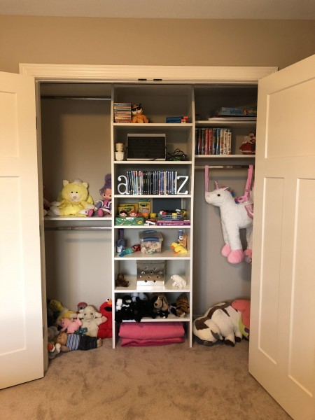 The closet in our niece's room is filled with toys and art supplies, all able to be used by any kiddo that visits