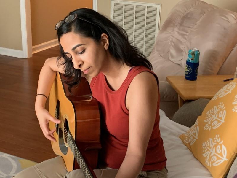 Nazli, practicing guitar