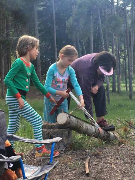 Chopping wood while camping