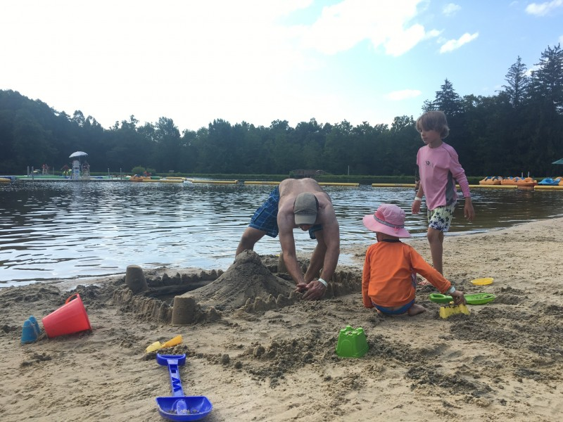 Building a sand castle at a lake