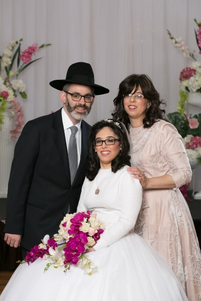 Elisheva with her parents, Avraham And Frumie Goldberg