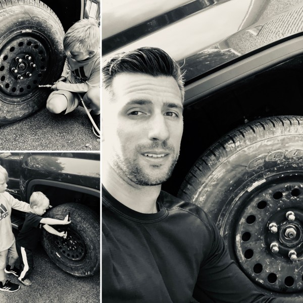 Learning to fix a flat tire with dad
