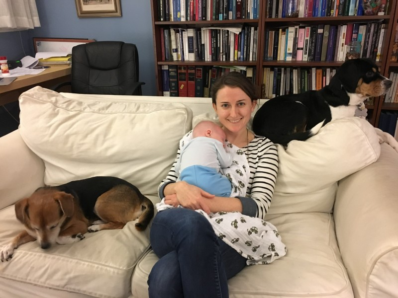 Snuggling with baby Marc and the dogs
