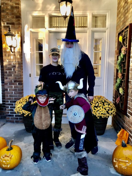 A wizard, an army recruit, a Viking and a dinosaur go trick or treating...