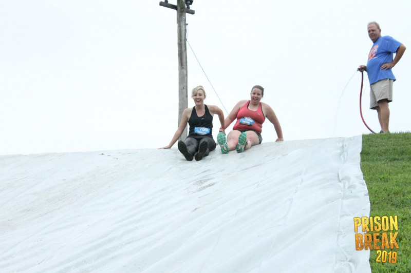 Tara and friend, Megan, at the finish of the Prison Break run! This was the fun obstacle!