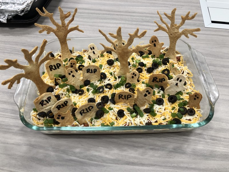 Tara's spooky graveyard 7 layer taco dip she made for work.