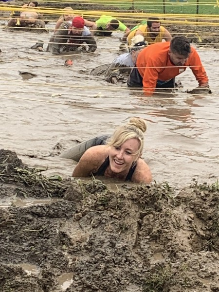 Crawling through the mud obstacle during the Prison Break run!