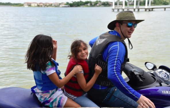 John playing the jet-ski-chauffeur for ten of our nieces and nephews.