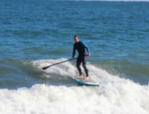 John paddle boarding in the ocean near our house