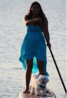 Veera paddle boarding with Ziggy near our house.