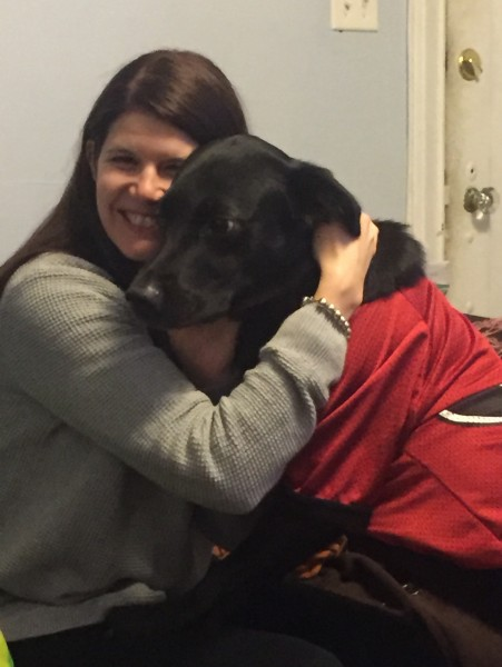 Brittany with our lab mix, Tank (in his UGA jersey)