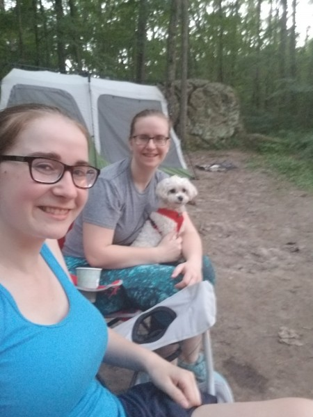 Maria and her sister sitting at our campsite