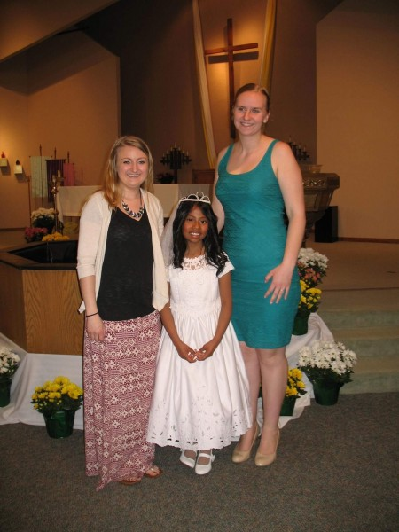 Maria and her cousins celebrating first communion