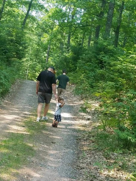 Maria's dad walking with our nephew in the northern woods