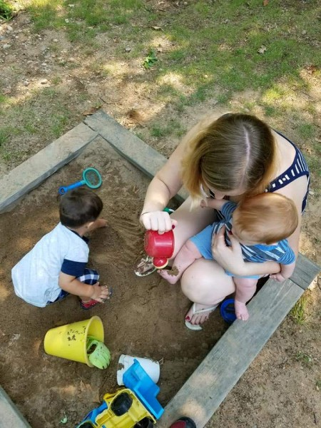 Maria playing with our nephews in the sandbox