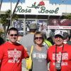 Craig and his sister and dad cheering for Badgers at the Rose bowl