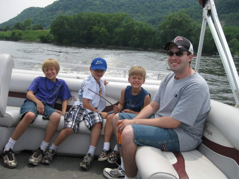 Craig and our nephews on a boat ride
