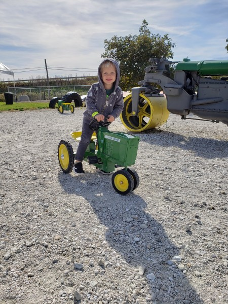 Family trip to Pumpkin Farm_Playing on some John Deer toys