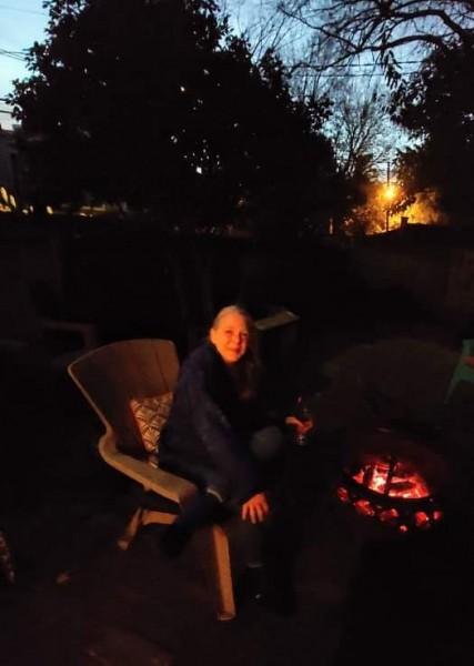 Grammy enjoying another evening fire